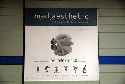 Subway ad for plastic surgery.
