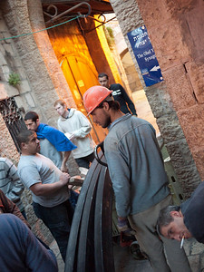 Meanwhile arabs are hauling construction material to build some shit up on their territory. I didn't understand why they had to carry these enormous things by hand through the old city instead of drive them in from the back on a truck.