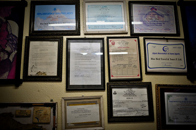Wall of certificates of the travel agent we bought the Everest flight tickets from