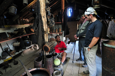 Our guide demonstrates how they grind coffee. Just kidding - rice probably