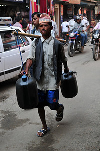 First of many - guy carrying stuff on his back. This seems to be the largest industry in Nepal - hauling shit.