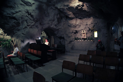 Next to the cafe and the bathhouse, there is a church in the wall. Literally - some cave.