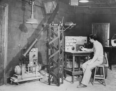 Engineering - Parker measuring light distribution pattern with photometer, University Archives, call number: 85S:3(21) © UB Archives   Please contact University Archives at lib-archives@buffalo.edu for permission to use this image.