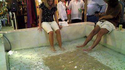 Night Market in Siem Reap, Cambodia. Fish eat dead skin of your feet. $3 for 15 minutes. Feels great, very ticklish at first.