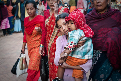 Women carry babies