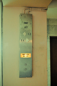 Apparently the genius designers decided to put the lift call button in the middle between two sets of lifts.  I wasn't the only one caught off guard - everybody else had the same problem.