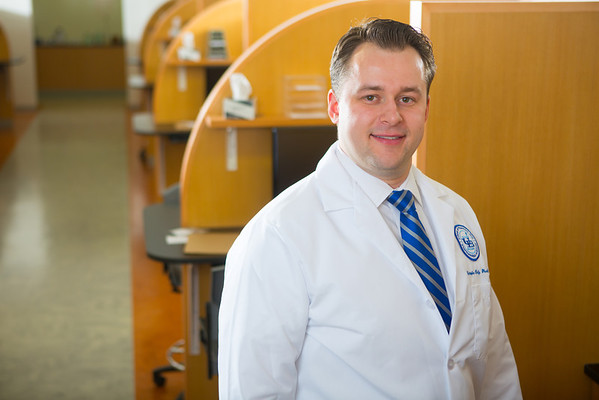 Portrait of Clinical Assistant Professor Christopher Daly in Kapoor Hall Lab<br /> <br /> Photograph: Douglas Levere