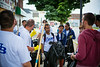 Aaron Krolikowski, at right tells SOM Students what they will be working on.<br /> <br /> Day of Caring with the School of Management in the University Heights<br /> <br /> Photographer: Douglas Levere