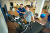 Sports Medicine Doctor John Leddy with Patient in the Sports Medicine Clinic on the UB South Campus in Farber Hall<br /> <br /> Photographer: Douglas Levere