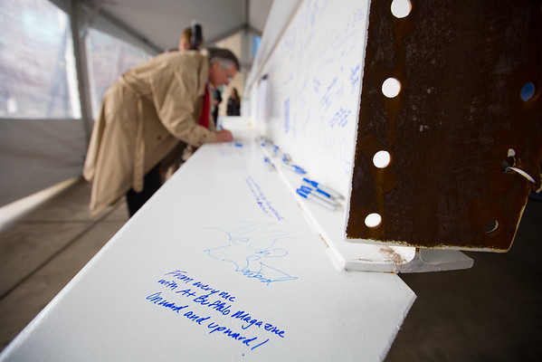 Beam Signing for the Jacobs School of Medicine and Biomedical Sciences Building at the South Campus Biomedical Education Building<br /> <br /> Photographer: Douglas Levere