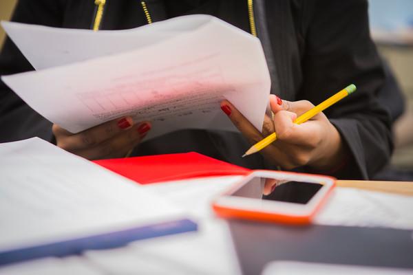 Economics teaching assistants tutoring students in Fronczak Hall<br /> <br /> Photographer: Douglas Levere