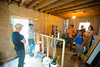 Architecture and planning students building a home for Habitat for Humanity<br /> <br /> Photographer: Douglas Levere