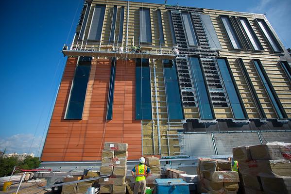 Installation of Boston Valley Terra Cotta Tiles on the Medical School Building.<br /> <br /> Photographer: Douglas Levere