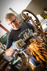 Brian Koyn and Ray Dannenhoffer renovating a light sconce from the original UB medical school building<br /> <br /> Photographer: Douglas Levere