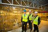From Left, Jacobs School of Medicine and Biomedical Sciences Dean Michael Cain, from HOK Architect Joshua Gardner and Takwig Louie, Project Architect, in the new Medical School Building under construction.<br /> <br /> Photographer: Douglas Levere