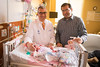 Satyanarayana Lakshminrusimha with a newborn at the Millard Fillmore Suburban hospital<br /> <br /> Photographer: Douglas Levere