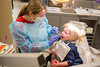 Dental students volunteering during Give Kids a Smile Day in Squire Hall<br /> <br /> Photographer: Douglas Levere