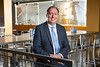 Portrait of Michaael Anderson, president of the UB Alumni Association, in Crossroads Culinary Center on North Campus.<br /> <br /> Photographer: Douglas Levere