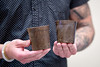 Matthew D. Mackintosh ('17) holds to 3 inch flower pots made by his company Buffalo Hemp Co. Mackintosh placed in the the Student Entrepreneur Fellowship Competition (eLab) presented in the Alfiero Center at the School of Management.<br /> <br /> Photographer: Meredith Forrest Kulwicki