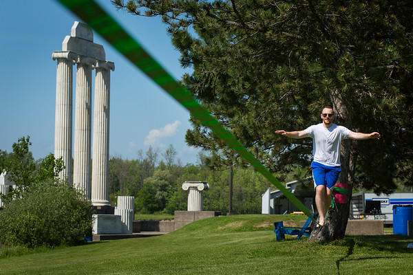 Dental student Ian Lieberman practices slacklining near Baird Point on north campus. <br /> <br /> Photographer: Meredith Forrest Kulwicki