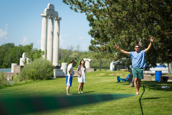 Ian Lieberman (left) and Shelby Lee talk while Mike Healy practices slacklining near Baird Point on north campus on a sunny Friay afternoon in June. All three are dental students.<br /> <br /> Photographer: Meredith Forrest Kulwicki