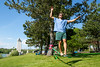 Dental student Mike Healy practicing slacklining near Baird Point on north campus on a sunny Friay afternoon in June. <br /> <br /> Photographer: Meredith Forrest Kulwicki