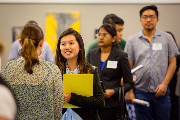 Kathy Cheng, class of '17, speaks with a representative of Ingram Micro at the UB Alumni to Alumni Job Fair at the Center for Tomorrow on June 13, 2017. <br /> <br /> Photographer: Meredith Forrest Kulwicki