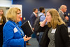 Mary Beth Lydon, '94, speaks with Leah Riley, of Homespace Corp. at the UB Alumni to Alumni Job Fair at the Center for Tomorrow on June 13, 2017.<br /> <br /> Photographer: Meredith Forrest Kulwicki