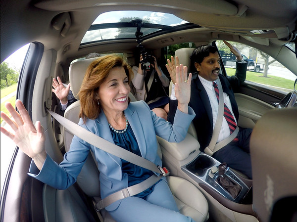 """Lieutenant Governor Kathy Hochul (left) and Prof. Ragunathan """"Raj"""" Rajkumar, of Carnegie Mellon University, ride in the driver-less Cadillac SUV developed by Carnegie Mellon University (CMU) on UB's North Campus on June 20, 2017.<br /> <br /> Photographer: Meredith Forrest Kulwicki"""