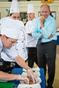 Jeff Brady (right) watches as a member of SUNY Geneseo finishes plating a dish during the SUNY Culinary Summit Competition held on June 22, 2017 in the Goodyear Dining Center.<br /> <br /> Photographer: Meredith Forrest Kulwicki