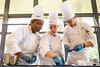 left to right: Amber Southerns, Stephanie Balk and Bronek Lis work to finish the details of their dessert during the SUNY Culinary Summit Competition held on June 22, 2017 in the Goodyear Dining Center.<br /> <br /> Photographer: Meredith Forrest Kulwicki