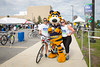 Katie Gesicki (left) and Veronica Stamp pose for a photo with Sabertooth Tiger of the Buffalo Sabres after their 20 mile ride. Over 7,300 riders participated in the 2017 Ride for Roswell raising $4.6 million, according to race organizers. Image from June 24, 2017 around University at Buffalo's North Campus.<br /> <br /> Photographer: Meredith Forrest Kulwicki