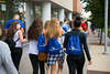Students on an orientation tour near Griener Hall on North Campus with the blue UB backpacks.<br /> <br /> Photographer: Douglas Levere