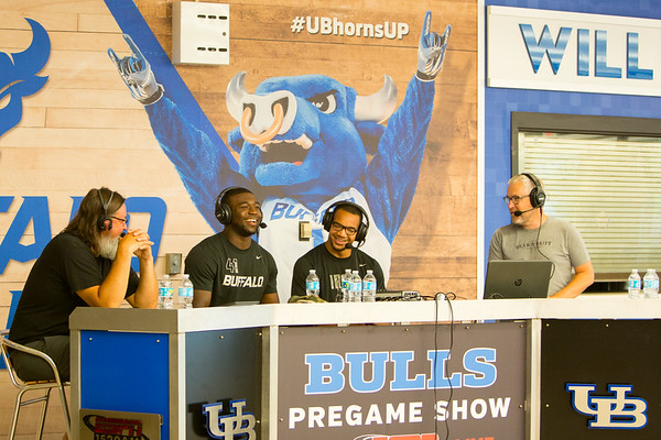 UB defensive end, Demone Harris, (center left) and linebacker Jarrett Franklin (center right) speak with WGR 550 hosts Chris 'The Bulldog' Parker (left) and Mike Schopp (right). They were on air to promote thea nnual flash sale for UB Football tickets at the box office at Alumni Arena. <br />  <br /> Photographer: Meredith Forrest Kulwicki
