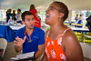 Yvette Gaines-Hicks (right) participates in a heath screening guided by nurrsing student Chris Streb (left) while at UB on the Green on July 19, 2017. Featuring Randle and the Late Night Scandals, this night is dedicated to health in the community with free health screenings provided by UBMD, UB Nursing and UB Dental, and fun activities for the children.<br /> <br /> Photographer: Meredith Forrest Kulwicki