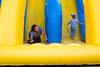 Kenedy Stockwell (right) enjoys the slide with her mother, Jessica Stockwell, at UB on the Green on July 19, 2017. Featuring Randle and the Late Night Scandals, this night is dedicated to health in the community with free health screenings provided by UBMD, UB Nursing and UB Dental, and fun activities for the children.<br /> <br /> Photographer: Meredith Forrest Kulwicki