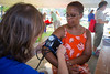 Yvette Gaines-Hicks (right) participates in a heath screening, including have her blood pressure measued by nursing student Chris Lomas while at UB on the Green on July 19, 2017. UB on the Green on July 19, 2017. Featuring Randle and the Late Night Scandals, this night is dedicated to health in the community with free health screenings provided by UBMD, UB Nursing and UB Dental, and fun activities for the children.<br /> <br /> Photographer: Meredith Forrest Kulwicki