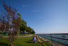 UB Art Galleries presents Kim Beck's skywriting event 'There Here' photographed in Lasalle Park in Buffalo, NY. A skywriter drawa arrows in the sky pointing to the US/Canadian border located over the Niagara River.<br /> <br /> Photographer: Meredith Forrest Kulwicki