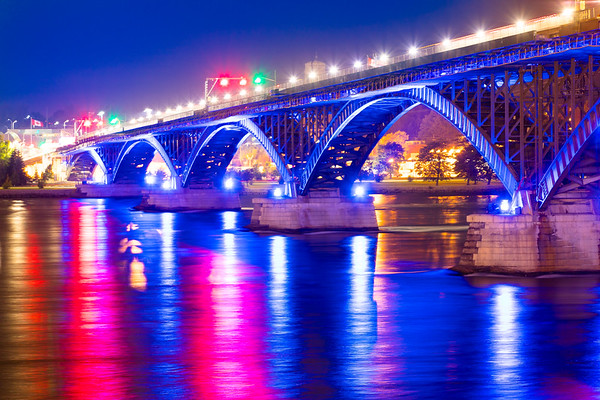 The Peace Bridge Lit Up in Blue and White to support the University at Buffalo Bulls Homecoming game.<br /> <br /> Photographer: Douglas Levere