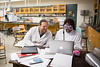 Prof. Jason Benedict works with students in the lab.  Physical chemistry lab with students in the Natural Sciences Complex.<br /> <br /> Photographer: Meredith Forrest Kulwicki