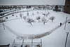 Snow and winter on North Campus including facilities clearing snow and people walking. <br /> <br /> Photographer: Meredith Forrest Kulwicki