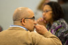 Cemal Basaran, a member of the SUNY Faculty Senate listens another person asks University at Buffalo President Satish Tripathi a question at the Annual Voting Faculty meeting at the Center for Tomorrow on May 9, 2017.<br /> <br /> Photographer: Meredith Forrest Kulwicki