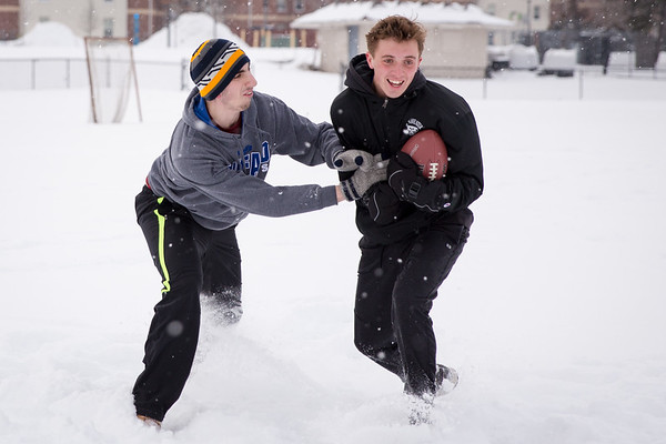 180013 Campus Life, sophomore students playing football in snow, Walter Kunz Field