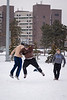 A group of sophomore friends play football in the snow on Kunx Field during winter break. <br /> <br /> Photographer: Meredith Forrest Kulwicki