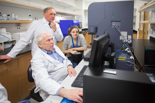 Wade J. Sigurdson, (Standing), and Raymond Kelleher, (Seated Center) with Students in the Confocal Microscope and Flow Cytometry Facility at the Downtown Medical School Building<br /> <br /> Photographer: Douglas Levere