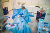 A staff member demonstrates simulation rooms in the Behling Center in the Medical School Building. <br /> <br /> Photographer: Douglas Levere