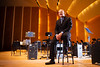 """Portrait of Graduate School of Education student Chris Vasquez on the stage at Kleinhans Music Hall. He will sing """"Over the Rainbow"""" with the Buffalo Philharmonic Orchestra as the winner of the BPO's """"Buffalo Sings"""" competition. <br /> <br /> Photographer: Douglas Levere"""