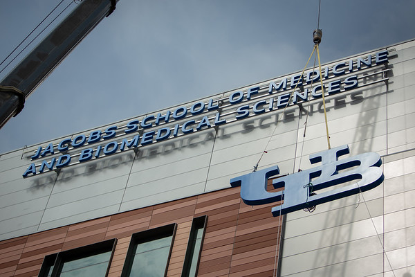 180232 Facilities, UB logo lift, East side, Medical School Building