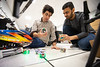 Graduate students work with autonomous vehicles inside the lab of Rahul Rai, with mechanical and aerospace in the School of Engineering and Applied Sciences. UB engineers have been awarded a $1 million Defense Advanced Research Projects Agency (DARPA) grant to combine physics-based models with conventional, data-driven AI methods.<br /> <br /> Photographer: Douglas Levere