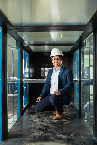 Students of engineering researcher Teng Wu, associate professor of civil, structural and environmental engineering, use the wind tunnel in Ketter Hall to examine the effects of extreme winds on a bridge. Photographed in October 2019.<br /> <br /> Photographer: Douglas Levere